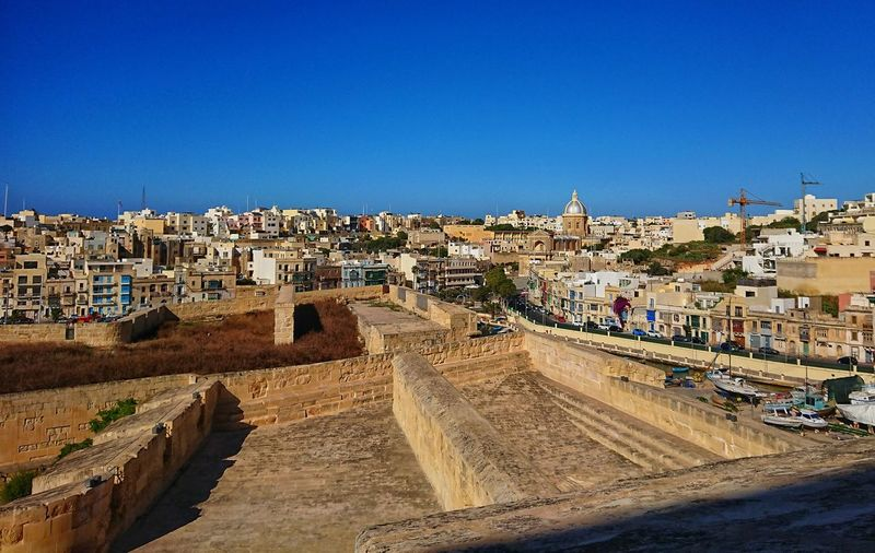 Cityscape of Birgu roofs EyeEm Selects Malta City Cityscape Clear Sky Sand Sky Architecture Building Exterior Built Structure Old Town TOWNSCAPE Rooftop Town Tiled Roof  Place Amphitheater Old Ruin Castle Housing Settlement Fort
