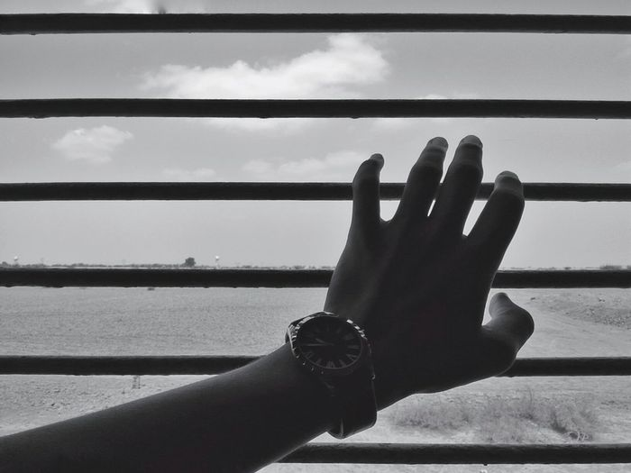 Journey away from home. Train Window Travel Blackandwhite Hand Watch Man First Eyeem Photo Feel The Journey Clouds Sky Adventure