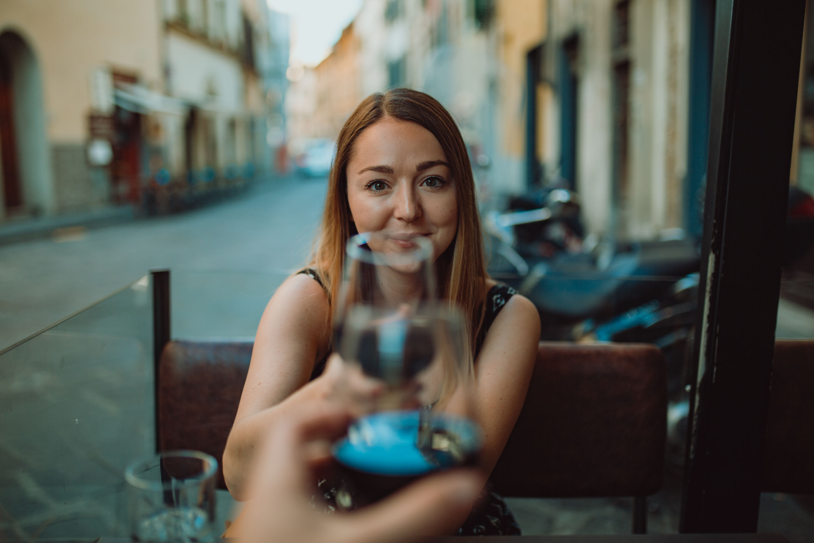 one person, portrait, young women, young adult, looking at camera, lifestyles, real people, long hair, front view, leisure activity, beautiful woman, hair, hairstyle, women, focus on foreground, holding, smiling, beauty, glass, drinking