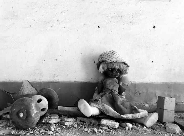 Toy sitting on wall