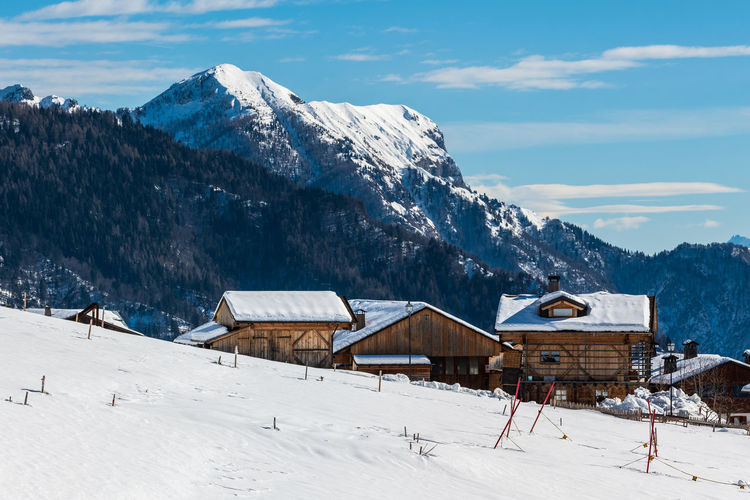 Winter magic. the ancient wooden houses of sauris di sopra. italy