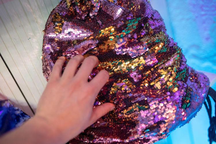 High angle view of woman with shiny bag on table