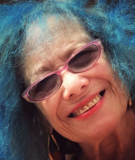 "Cheerful Happiness Fun Sunglasses Human Face Toothy Smile One Person Excitement Human Body Part Celebration What A Lovely Lady she's 77 and they call her ""blue haired mama"" Headshot People Multi Colored Beauty Smiling Women One Girl Only Portrait Adult Holi In Vero Beach Florida Usa The Week On EyeEm The Portraitist - 2017 EyeEm Awards"