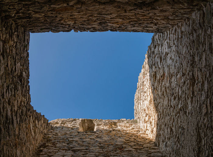 Old ruins against clear blue sky