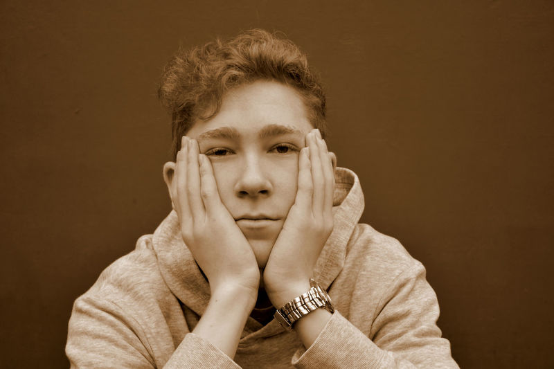 Adult Boy Close-up Day Front View Head In Hands Headshot Human Hand Indoors  Looking At Camera One Person People Portrait Real People Studio Shot Teenage Boy Teenager Young Adult