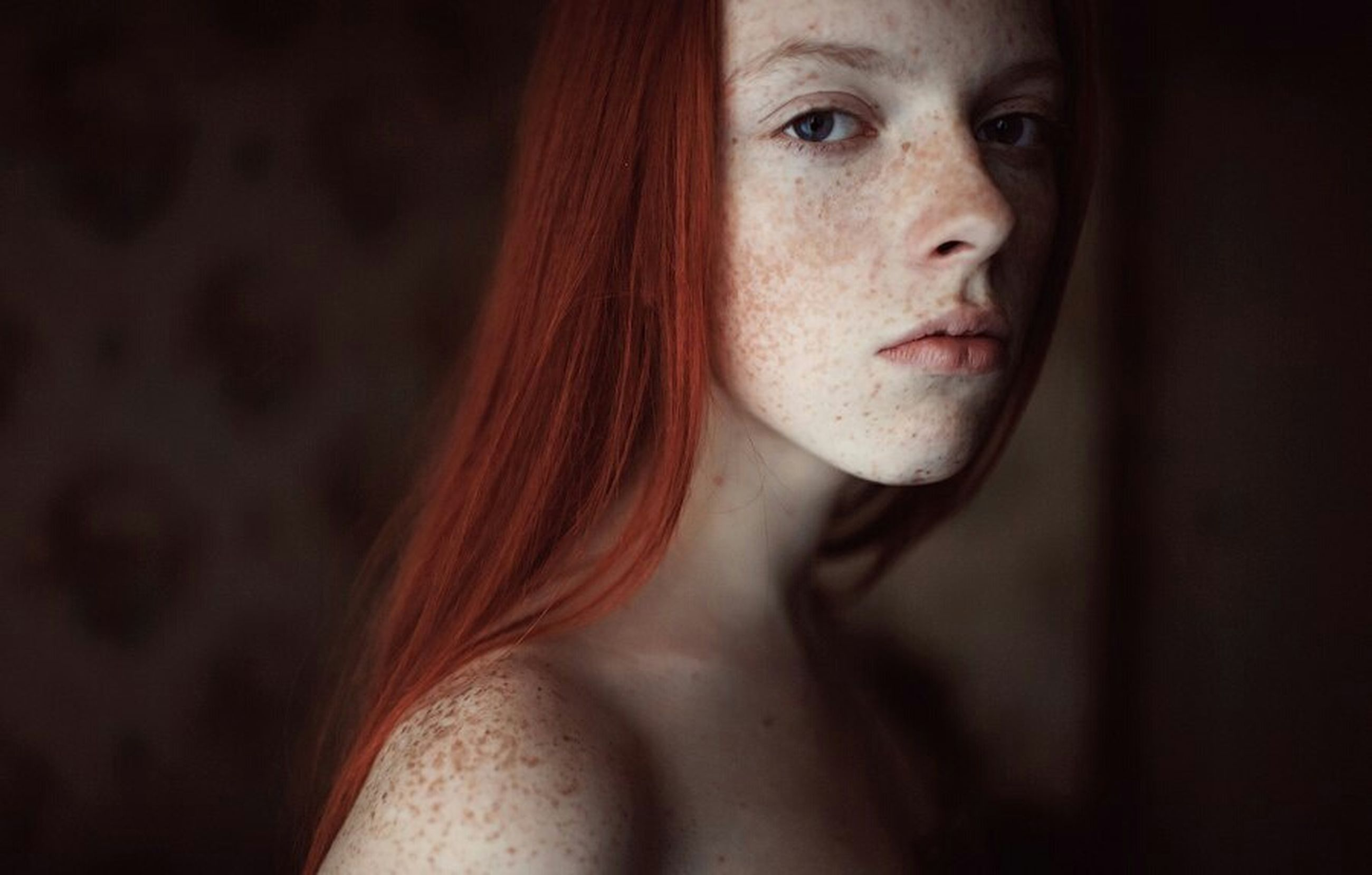young adult, headshot, young women, person, lifestyles, portrait, indoors, contemplation, looking at camera, close-up, front view, serious, leisure activity, human face, head and shoulders, long hair