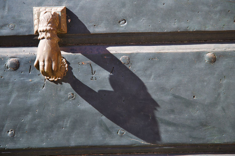 Close-up of hand-shaped door knocker