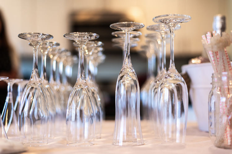 Close-up of glass wine glasses on table
