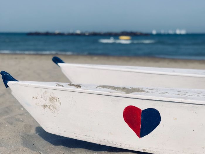 EyeEm Selects Water Heart Shape Focus On Foreground Red Sea Day Beach Blue Sand Emotion Outdoors Positive Emotion