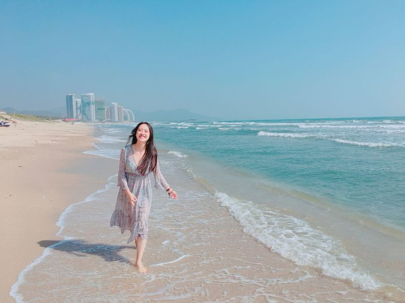 Dance with spindrift. Smile Laughing Clearbluewater Spindrift Beach Long Hair Sea Sand One Person Full Length Young Adult Beautiful Woman Leisure Activity Vacations