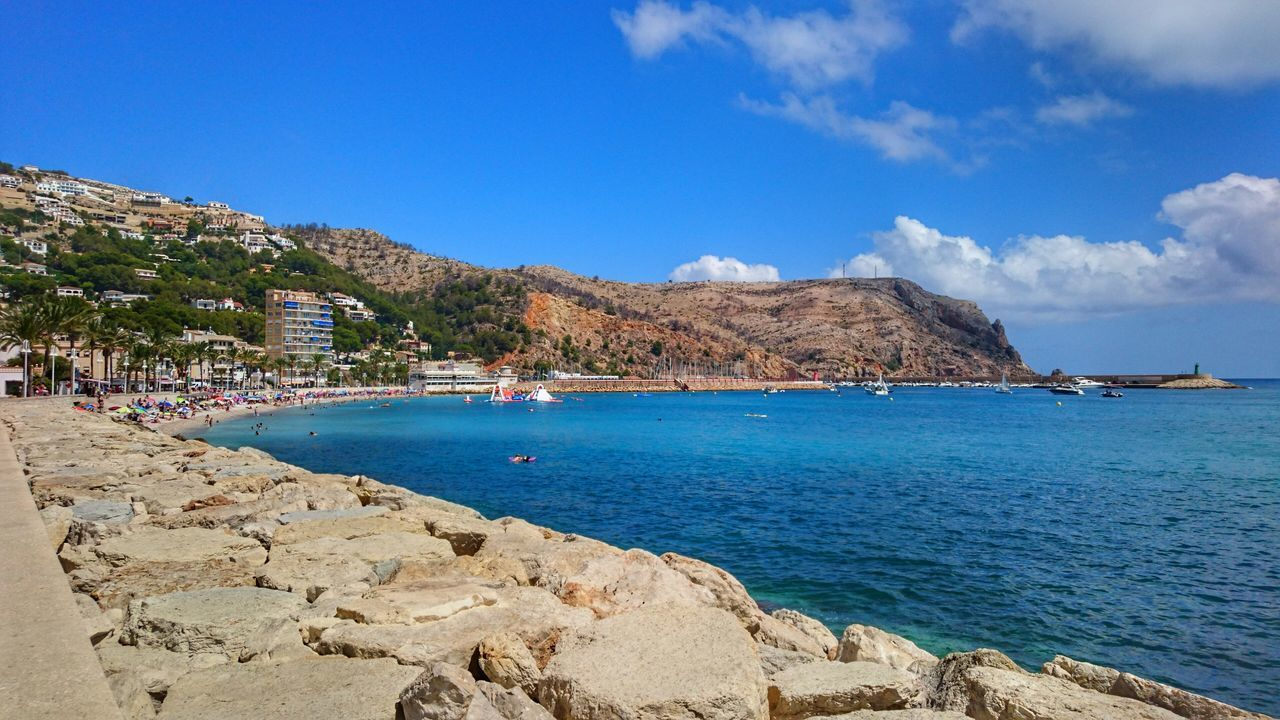 Scenic View Of Sea By Mountain Against Sky At Javea