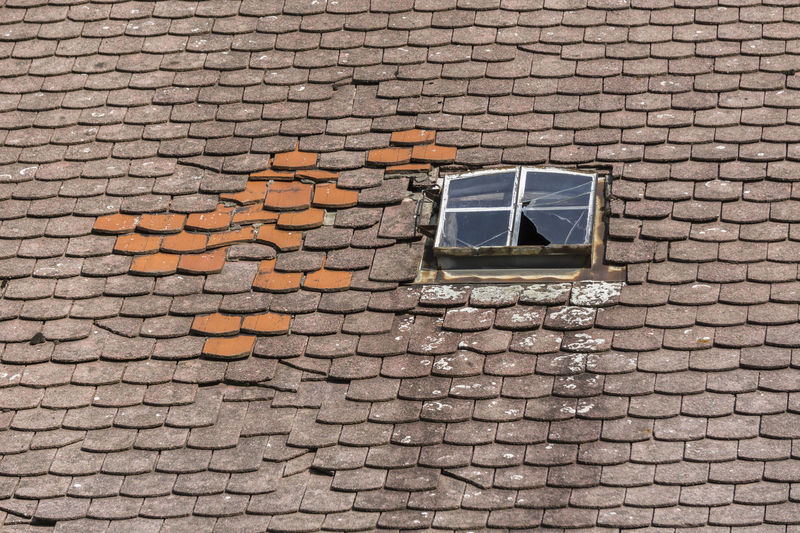 Old broken tile roof with damaged window in Germany. Architecture Brocken Damaged Day No People Old Outdoors Roof Window