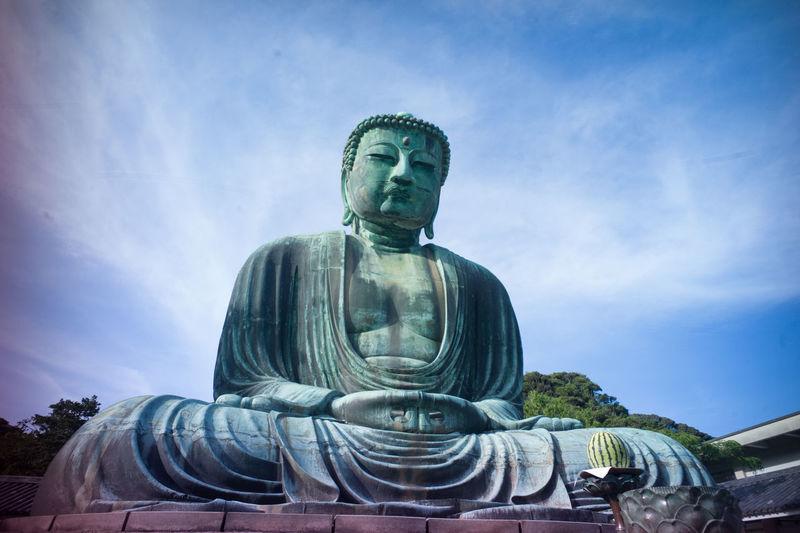 Low angle view of statue of big buddha in kamakura, japan