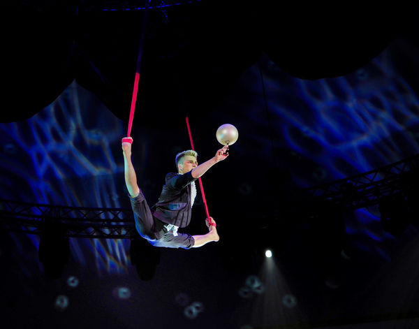 Russia, Moscow. the Nikulin circus, trapeze Adult Adults Only Astronomy Circus Indoors  Moscow Night One Man Only One Person People Russia Russian Circus The Nikulin Circus Trapeze Trapeze Artist