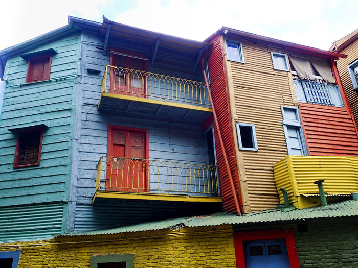 details of multicolored house facades in La Boca, Buenos Aires House Facade La Boca, Buenos Aires Building Exterior Built Structure House Houses And Windows Iron Stairs Low Angle View Multi Colored Multicolored Facade Multicolors  No People Outside Stairs Window