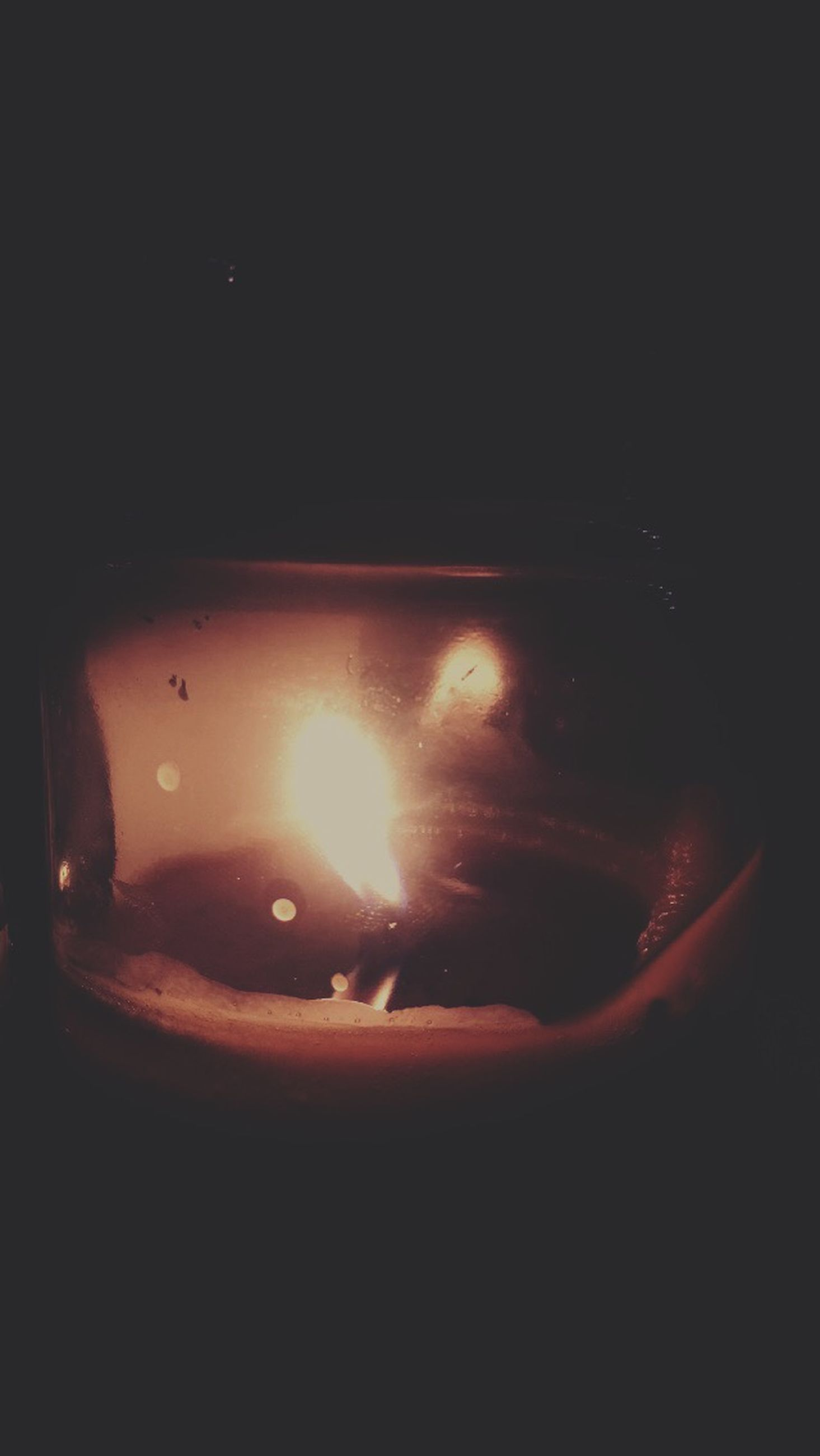 burning, indoors, flame, heat - temperature, fire - natural phenomenon, illuminated, glowing, dark, close-up, candle, lit, copy space, night, fire, black background, still life, light - natural phenomenon, darkroom, candlelight, lighting equipment