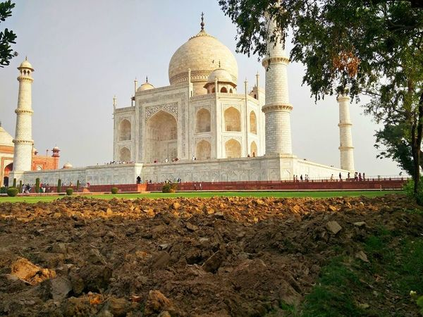 mesmerizing beauty of Taj City Dome Politics And Government Place Of Worship Tree Religion Cultures Marble Sky Architecture Mausoleum Tomb Historic Civilization Monument Calligraphy Archaeology National Monument