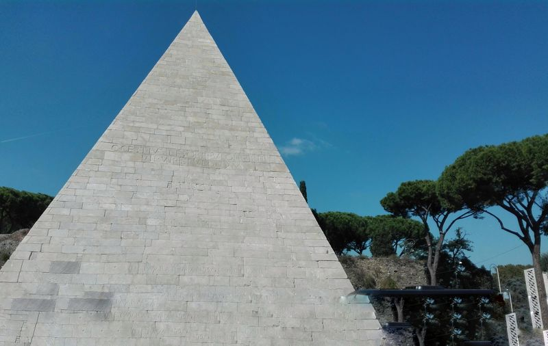 monument in Rome: piramide cestia Rome, Italy EyeEmNewHere EyeEm Gallery Ancient Civilization Clear Sky Pyramid Blue History Ancient Triangle Shape Shape The Past Sky Pyramid Shape Tomb Egyptian Culture Monument Archaeology Geometric Shape