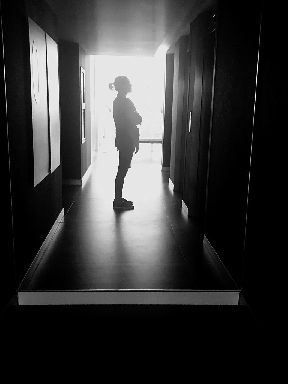 full length, one person, real people, indoors, architecture, lifestyles, standing, men, building, built structure, silhouette, arcade, day, corridor, leisure activity, entrance, sunlight, door, rear view