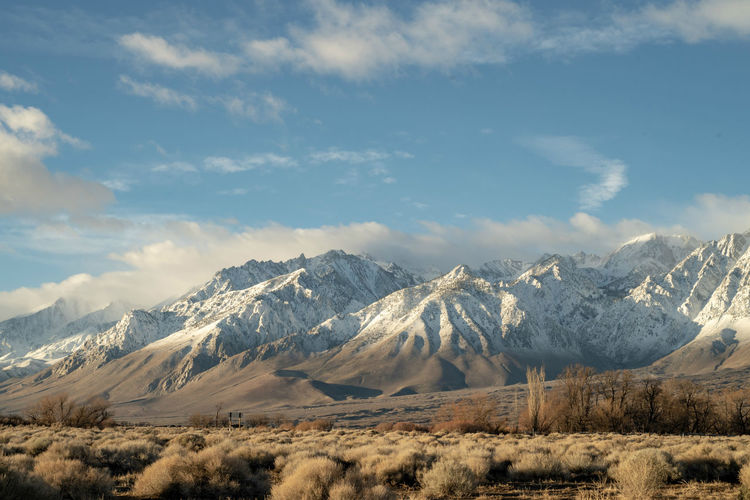 snowy peaks of mountain range of Eastern Sierra Nevada mountains in California, USA Mountain Snow Cold Temperature Winter Scenics - Nature Snowcapped Mountain Beauty In Nature Mountain Range Sky No People Nature California Sierra Nevada Mountains Mountain View Travelling Wintertime Winter Landscape Winter Landscapes Blue Sky And Clouds Nature On Your Doorstep
