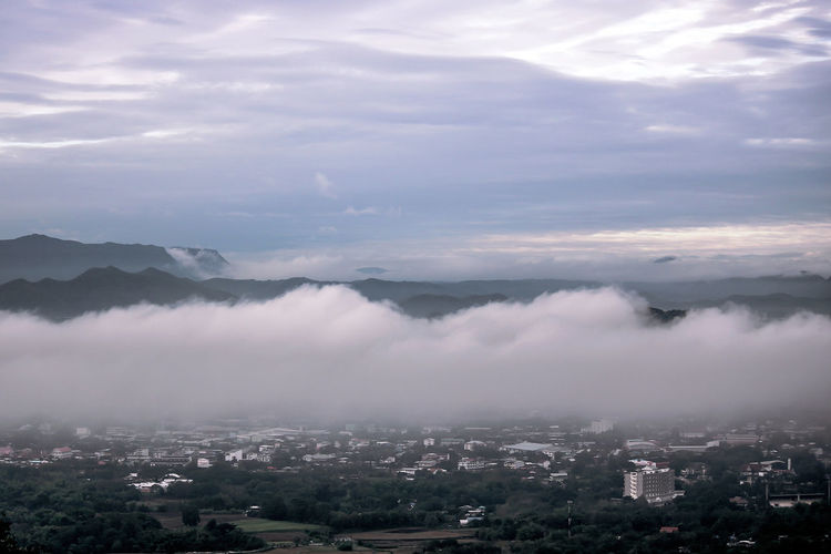 Soft focus Scenic Landscape view for background with Soft light in morning beautiful sunrise, cloudy and foggy sea of wave fog look like around the mountain over city at Phu Bo Bid, Loei, Thailand. Cloud - Sky Sky Scenics - Nature Beauty In Nature Mountain Nature No People Fog Day Mountain Range Environment Outdoors Clouds And Sky Morning Sky Sea Fog Scenics Beauty In Nature Weaving City Landscape Season  Backgrounds Misty Morning Mist Morning Nature Nature Photography Point Of View Rays Of Light Autumn Asian  Thailand Nationalpark Hill Valley Countryside Cold Coulds And Sky Dew Foggy Foggy Morning