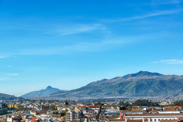 View of Quito, Ecuador with large green hills in the background Architecture Basilica Building Built Structure City Cityscape Colonial Concrete Destination Downtown Ecuador Green Hills Historic Landmark Monument Neogothic Outdoors Quito Residential Building Tourism Town Travel Urban Vacation View
