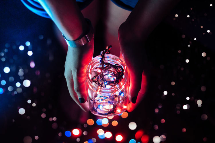 Close-up Illuminated Ideas Creativity Person Extreme Close-up Modern Culture Pretty Jar Lights Light Reflection Recessed Light Tail Light Modern Colorful Blue Dark Technology Night Multi Colored Girl Holding Fresh On Market 2016