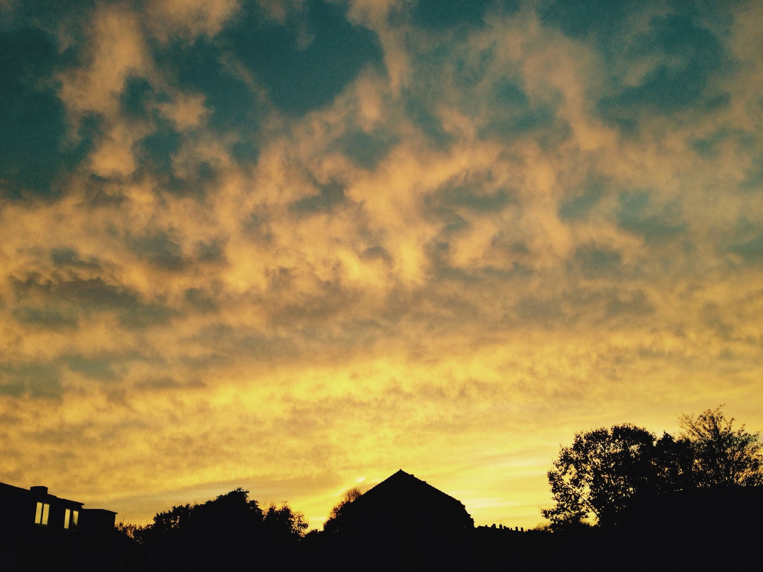 sunset, silhouette, sky, building exterior, architecture, built structure, cloud - sky, orange color, beauty in nature, tree, low angle view, scenics, cloud, dramatic sky, nature, house, cloudy, outdoors, tranquility, tranquil scene