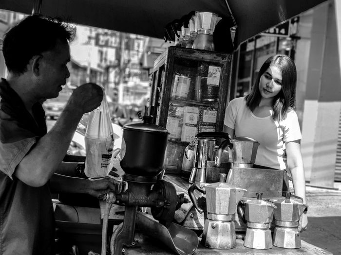 Young couple standing at market stall