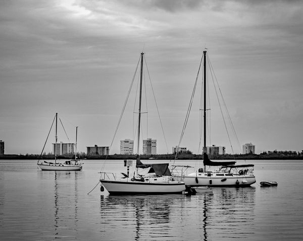 Awaiting the Wind Nautical Vessel Sky Water Transportation Boat Mode Of Transport Moored Harbor Day Cloud - Sky Outdoors Waterfront Mast No People Sailboat Architecture Sea Nature Yacht EyeEmNewHere EyeEm Best Shots EyeEmSelect Breathing Space The Week On EyeEm