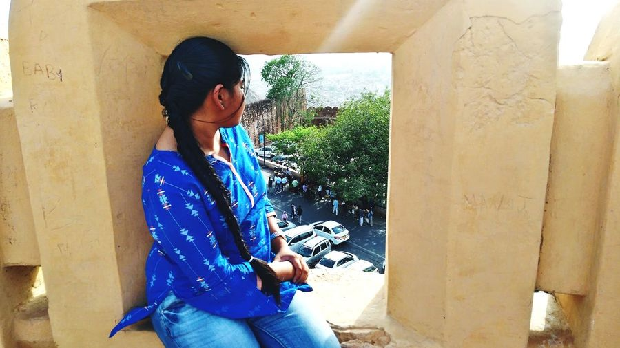 Art Nature Dusk Free Candid Blue Color Window Fort Pattern Shades Pleasant Yellow Brown Shadow Shades Of Green  Colourful Sitting Gazing Site Seeing Indian Wear NahargarhFort EyeEm Selects Portrait Women Young Women Human Hand Blue Standing Sunlight Pixelated Exterior Urban Scene Thoughtful