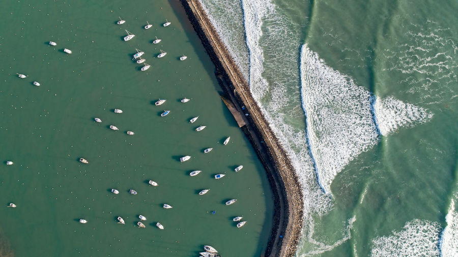 Aerial photo of boats sheltered in Jard sur Mer port, Vendée, France Jard Sur Mer Port Marina Vendée France Boat Sailboat Sailing Ship Nautical Vessel Mode Of Transportation Water Atlantic Ocean Sea Green Color Motion Beauty In Nature High Angle View Directly Above Sunlight Rock Seawall Aerial View Aerial Photography The Week on EyeEm Wave