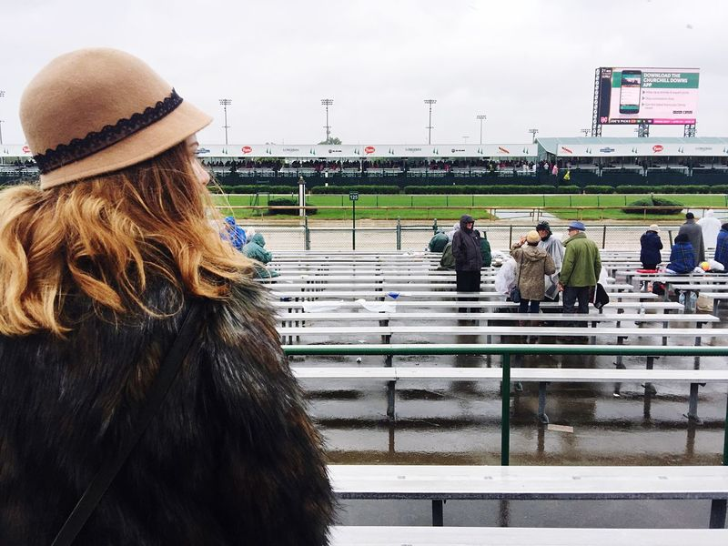 Rainy Kentucky Oaks... Horse Racing Racetrack Churchill Downs Kentucky Derby Kentucky Oaks EyeEm Selects Hat Clothing Real People Lifestyles Women Winter One Person Adult Incidental People Leisure Activity Warm Clothing Day Nature Knit Hat Rear View Sky Cold Temperature Architecture Outdoors