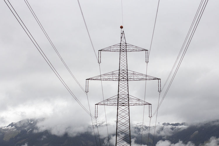 Austria Austrian Alps Cloudy Dramatic Sky Shades Of Winter The Alps Winter Cable Cloud - Sky Clouds Day Electricity  Electricity Pylon Fuel And Power Generation Low Angle View Mountain Nature No People Outdoors Power Line  Power Supply Rough Surface Salzburg Sky Technology