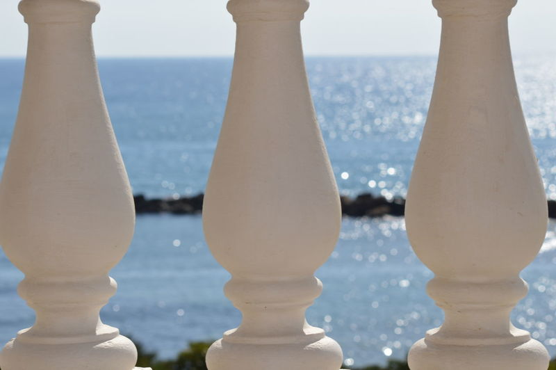 Close-up of chess against the sea