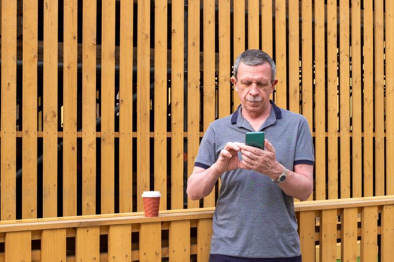 Full length of man working on mobile phone