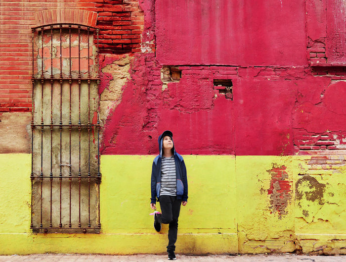 Boy Standing In Front Of Building