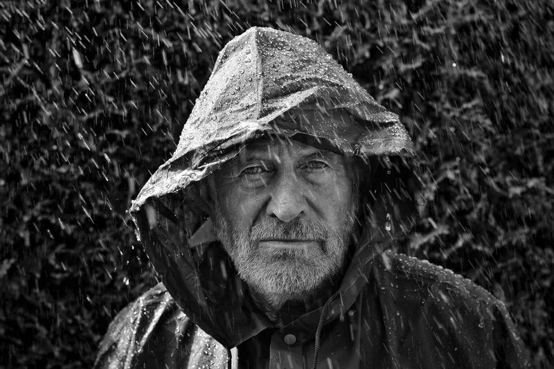 Portrait Of Man Wearing Raincoat During Rainfall