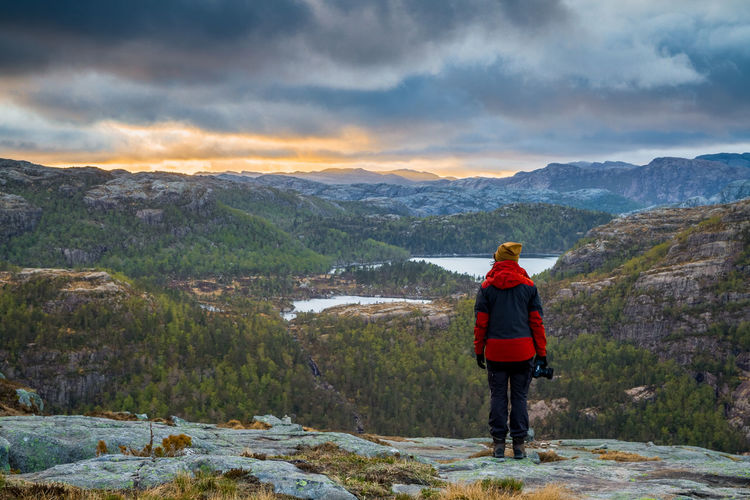 Sunset in the Norwegian mountains. Adult Beauty In Nature Camera Dengler Forest Girl Hiking Matthias Mountain Range Mountains Nature Nature Norway One Person Outdoors Preikestolen Pulpit Rock Snapshopped Stavanger Sun Sunset Tourism Travel Travel Destinations