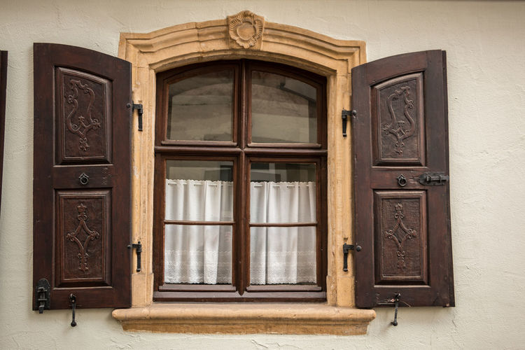 Old window made of stone and wood with brown shutters Architecture Built Structure No People Closed Window Building Door Building Exterior Day Entrance Safety Security House Wood - Material Protection Wall - Building Feature Outdoors Glass - Material