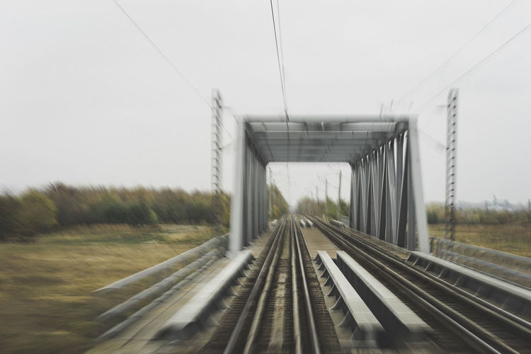 Autumn Motion Motion Blur Long Exposure Railroad Track Rail Transportation Built Structure vanishing point Diminishing Perspective Railroad Tie Railway Bridge Railroad Bridge Public Transportation Train - Vehicle Empty Road