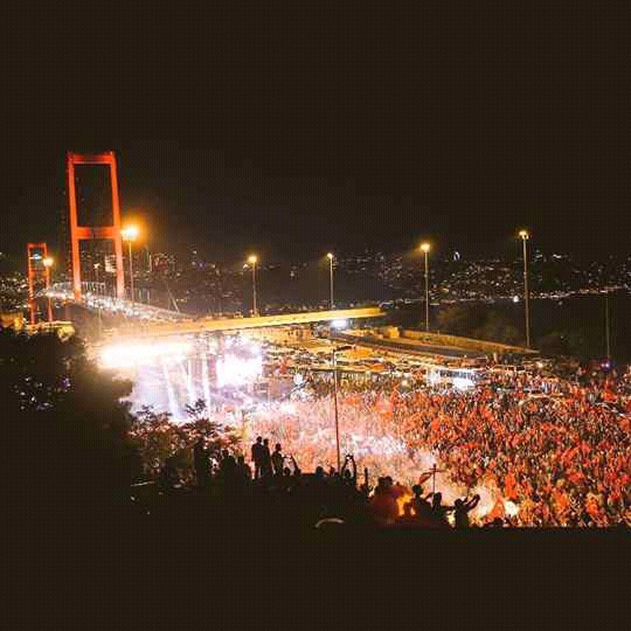 night, illuminated, street light, crowd, event, outdoors, large group of people, nightlife, city, popular music concert, sky, people