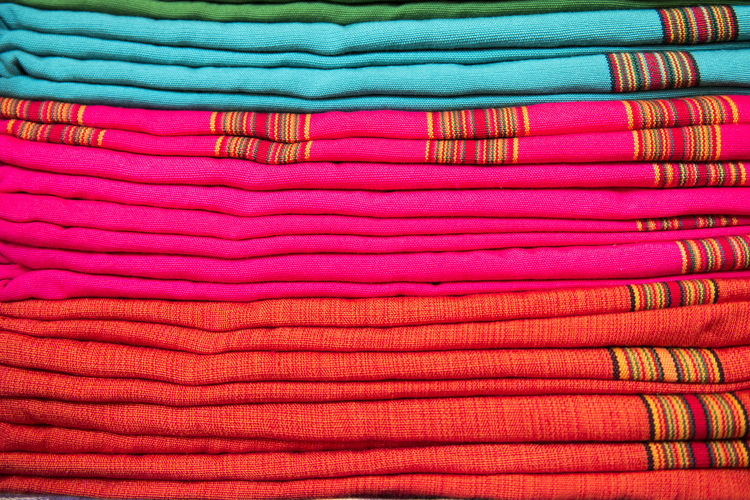 Close-up of colorful stacked fabric