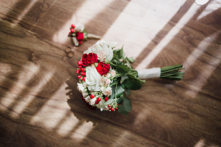 High angle view of flowers on wooden table