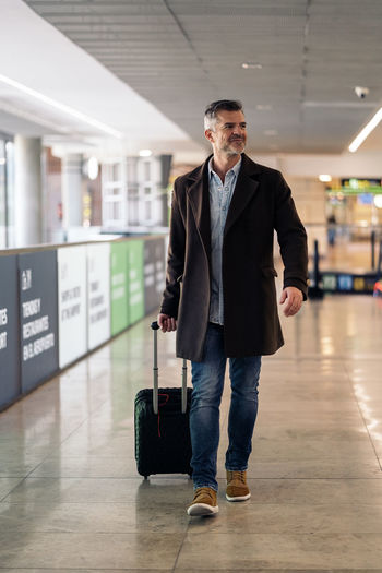 Full length of man standing at airport