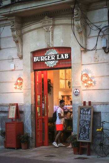 Burger Burger Time Palma Palma De Mallorca Architecture Building Exterior Built Structure City Communication Day Full Length Hamburger Lifestyles Men Occupation Outdoors People Real People Restaurant Standing Text Two People Walking Women Working