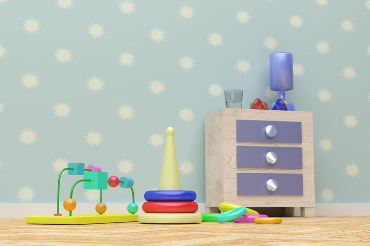 Toys on table against wall at home
