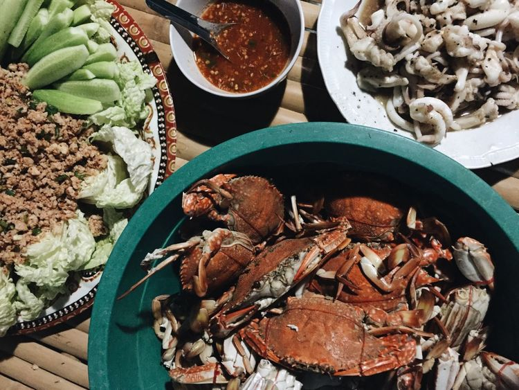 One of the best moments in my Freelance Life is having this awesome Seafoods cooked in Thai style at the Fisherman village in Chantaburi , Thailand . Showcase: February EyeEm Thailand Food Foodporn Thai Food Seafoodporn IPhoneography ShotOniPhone6 EyeEm Best Edits EyeEmFiveSenses Crab Squid Spicy Food Vegetables