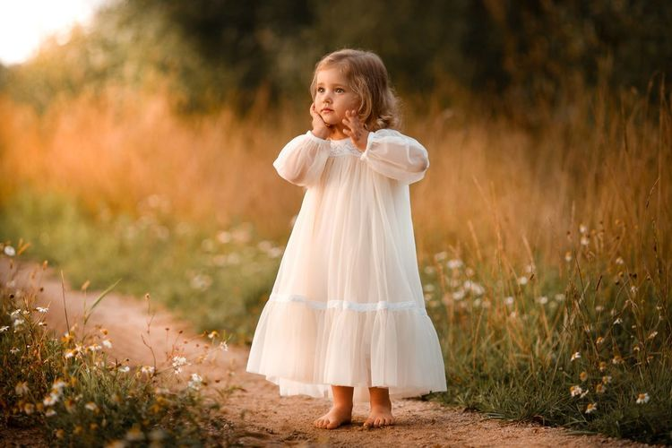 Girl standing on field