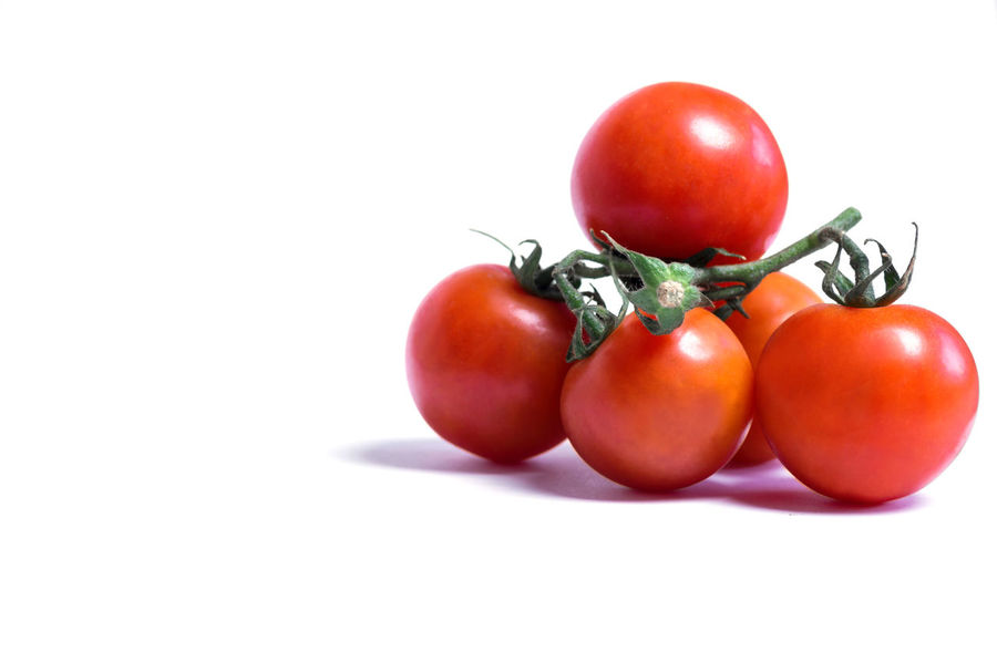 Close-up of fresh Red Tomatoes isolated on white Background. Tomato Food Food And Drink Fruit Wellbeing Healthy Eating Freshness White Background Studio Shot Vegetable Red Still Life Indoors  Close-up Cut Out Copy Space Raw Food No People Ripe Cherry Tomato Isolated Isolated On White Food And Drink Concept Red